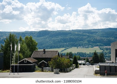 living houses with mountains behind in Lillehammer, Oppland, Norway