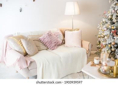 Living interior with sofa and chrismas tree
