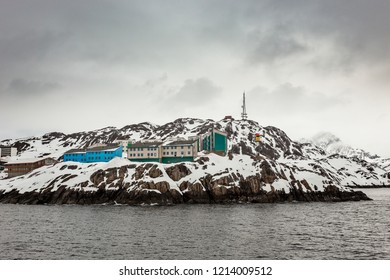 Living Inuit houses on the steep cliff covered in snow at the fjord, Maniitsoq town  Greenland