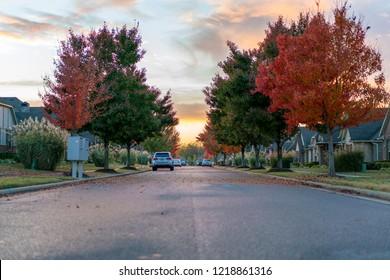 Living in Residential Housing Neighborhood Street at Sunset in Bentonville Arkansas