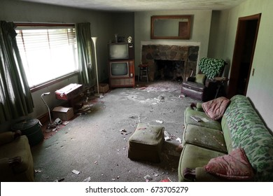Living room of an abandoned house, trapped in time. Natural light.