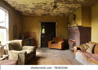 Living room of an abandoned and neglected farmhouse. Natural light.