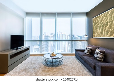 living room with big window and TV interior