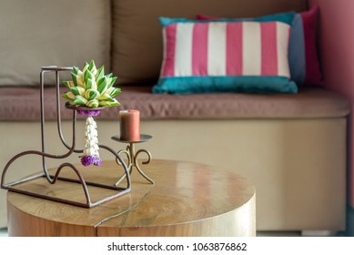 Living room decoration with bunch of flower (Asian tradition garland) over sofa background