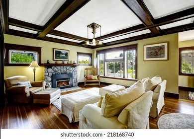 Living room design idea. Coffered ceiling blend with stone trim fireplace and rustic rocking bench