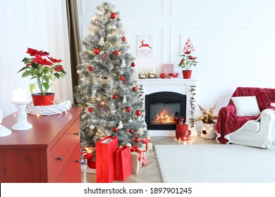 Living room with fireplace and Christmas decorations. Festive interior design