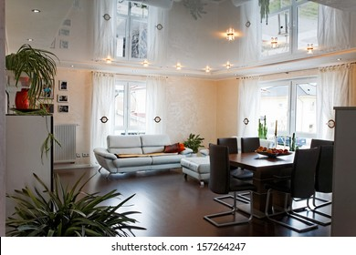 Living room with halogen lighting on a PVC ceiling.