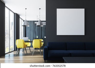 Living room interior with black walls, a square poster, a blue sofa near a coffee table and a dining room in the background. 3d rendering mock up
