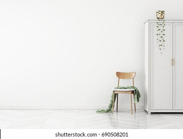 Living room interior with chair, plaid and wardrobe on empty white wall background. 3D rendering.