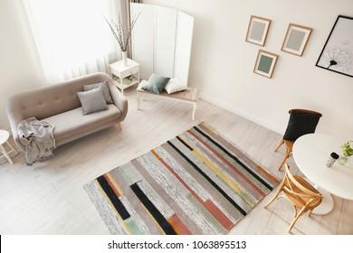 Living room interior with comfortable sofa, view through CCTV camera