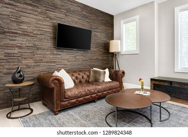 Living Room Interior and Den in Luxury Home with Rock Wall