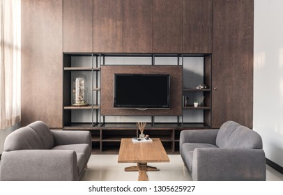 Living room interior in gray sofa and brown wood furniture luxury