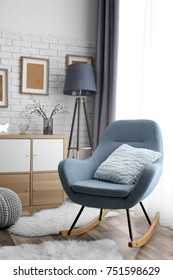 Living room interior with grey rocking chair and pillow