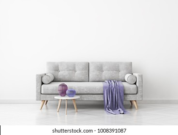 Living room interior with grey velvet sofa, violet plaid, vases and coffee table on empty white wall background. 3D rendering.