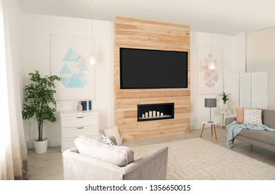Living room interior with modern TV on wooden wall