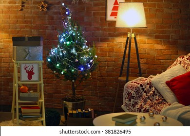 Living room interior with sofa, lamp and Christmas tree on brick wall background