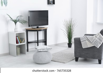 Living room interior with tv set on stand