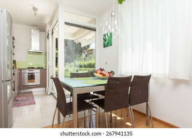 living room with kitchen and dining area