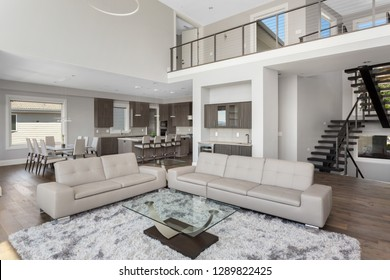 Living Room and Kitchen in New Luxury Home. Features Open Concept Floor Plan.