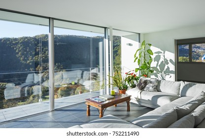 Living room with landscape view on the mountains and lake