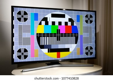Living room with LCD television displaying multi colored test screen