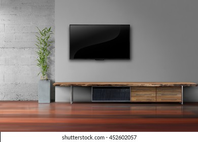 Living room led tv on gray wall with wooden table and plant in pot modern loft style