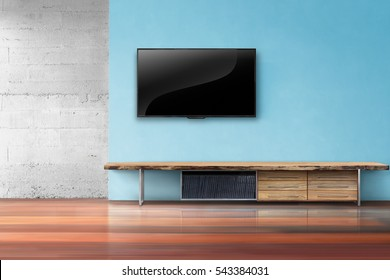 Living room led tv on brick wall with wooden table and plant in pot empty interrior