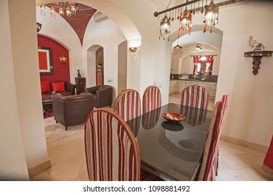 Living room lounge area in luxury apartment show home showing interior design decor furnishing with dining table