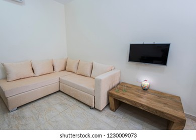 Living room lounge area in luxury apartment show home showing interior design decor furnishing