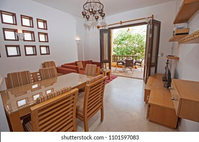 Living room lounge in luxury apartment show home showing interior design decor furnishing and dining area