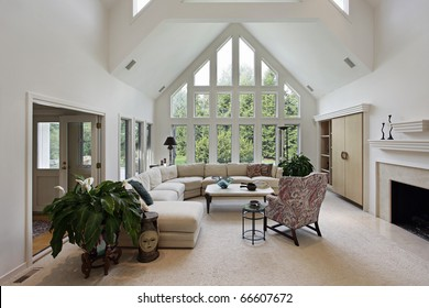 Living room in luxury home with floor to ceiling windows