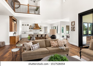 Living Room in Luxury Home with View of Kitchen and Eating Nook. Large, Open Concept Floorplan Filled with Natural Light.