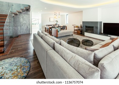 Living room modern interior design with stairs, grey colours, white walls