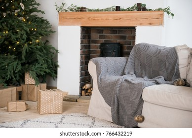 Living room in Scandinavian style with a Christmas decor. Holiday background. New Year's decorations.