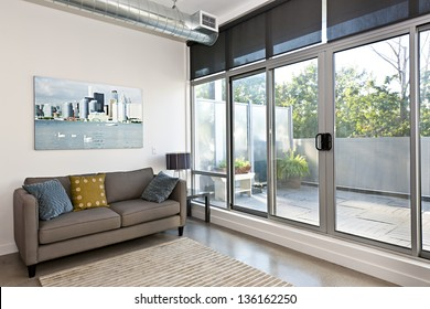 Living room with sliding glass door to balcony