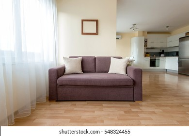 living room with a sofa, windows and curtains - copy space
