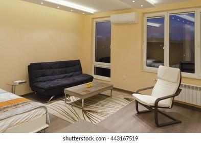 Living room space in small apartment through night, Sofia, Bulgaria