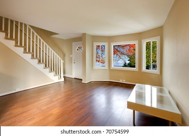 Living room with staircase and nice cherry floor