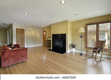 Living room in suburban home with fireplace