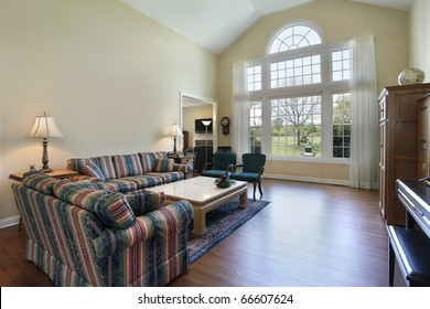 Living room in suburban home with hardwood flooring
