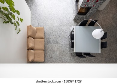 Living room with table, chairs and sofa with upper floor. View from above