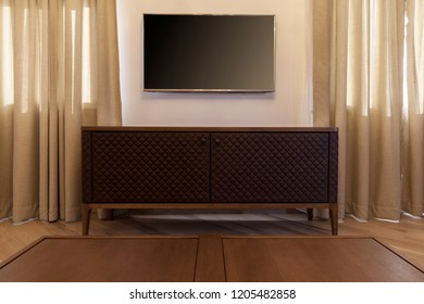 living room, tv on wall and coffe table