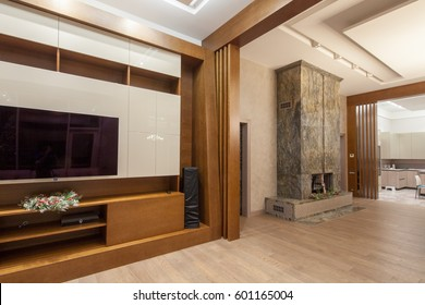 Living room with TV and TV stand, fireplace