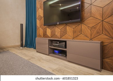 Living room with TV stand, TV, turquoise curtains and carpet