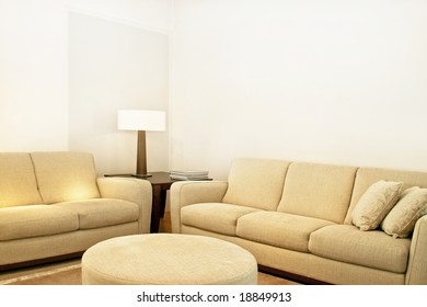 Living room with two beige textile sofas