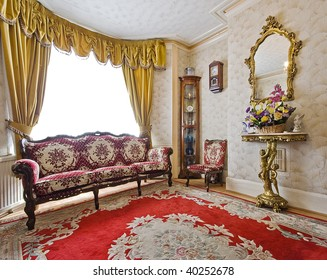 living room of a victorian house with antique furniture