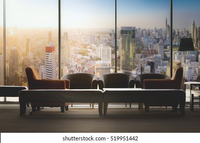 living room which can see cityscape at sunset, comfortable sofa unit in front of panoramic view windows overlooking the cityscape