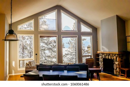 Living room with wide big windows typical for mountain style in Canada