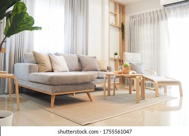 livingroom area white and light wood tone interior house japanese style