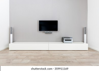 Living-Room interior with large grey wall
